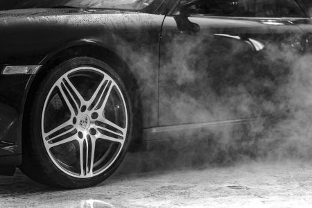 Car tire in mist